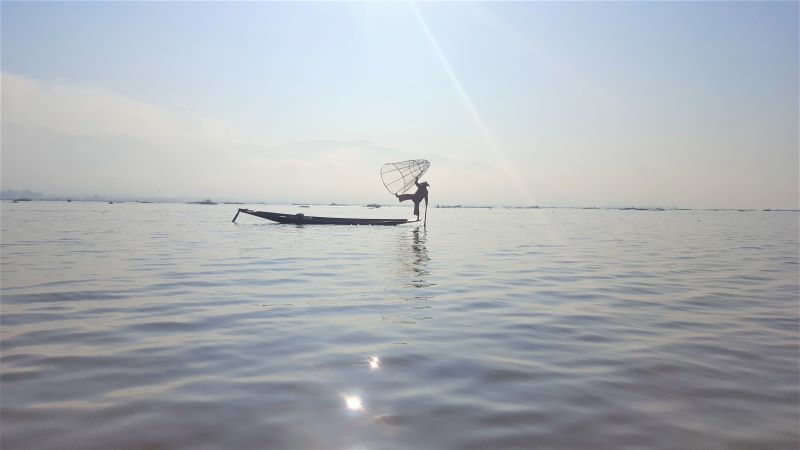 Fisherman showcasing his other talent at Inle Lake