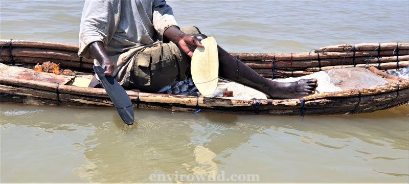 Fisherman using plastic oars