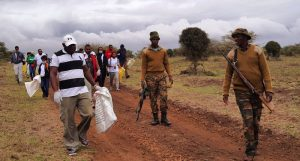 The team walking as they collect trash escorted by KWS wardens